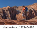 hiker on a trail in volcanic... | Shutterstock . vector #1124664902