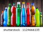 plastic bottles of assorted... | Shutterstock . vector #1124666135