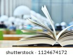 books lying on the table in the ... | Shutterstock . vector #1124674172