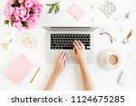 female workspace with female... | Shutterstock . vector #1124675285