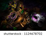 multiple mardi gras masks on a... | Shutterstock . vector #1124678702