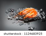 shrimps. fresh prawns on a... | Shutterstock . vector #1124683925