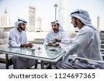arabic business men spending... | Shutterstock . vector #1124697365