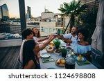group of friends having fun on... | Shutterstock . vector #1124698808
