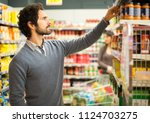 man picking up a product in a... | Shutterstock . vector #1124703275