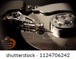 inside of hard disc or pc disc... | Shutterstock . vector #1124706242