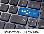 USB signs on enter key of keyboard, for concepts of USB ready devices. - stock photo