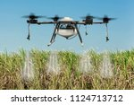 agriculture drone flying and... | Shutterstock . vector #1124713712