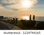 two bikers taking break at the... | Shutterstock . vector #1124744165