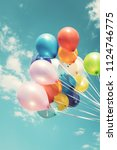 colorful festive balloons over... | Shutterstock . vector #1124746775