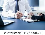 businessman hand signing... | Shutterstock . vector #1124753828