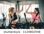 woman workout at sport gym by... | Shutterstock . vector #1124802548