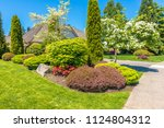 flowers  nicely trimmed bushes... | Shutterstock . vector #1124804312