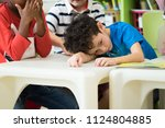 caucasion boy kid with sadness... | Shutterstock . vector #1124804885