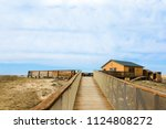 view of a small house with a... | Shutterstock . vector #1124808272