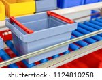 plastic boxes on the roller... | Shutterstock . vector #1124810258