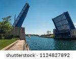 opened draw bridge in... | Shutterstock . vector #1124827892