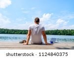 man sitting with laptop and... | Shutterstock . vector #1124840375