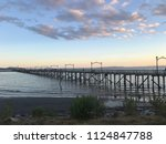 white rock  evening view for... | Shutterstock . vector #1124847788