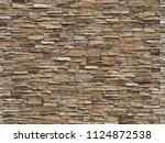 stone cladding wall made of ... | Shutterstock . vector #1124872538