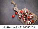 bruschetta with mozzarella and... | Shutterstock . vector #1124885156