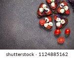 bruschetta with mozzarella and... | Shutterstock . vector #1124885162