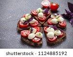 bruschetta with mozzarella and... | Shutterstock . vector #1124885192