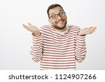 waist up shot of careless funny ... | Shutterstock . vector #1124907266