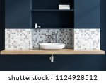 white vessel sink standing in a ... | Shutterstock . vector #1124928512