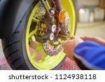 motorbike repair shop | Shutterstock . vector #1124938118