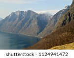 mountains with snow  fjords ... | Shutterstock . vector #1124941472