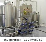 equipment for milk processing....   Shutterstock . vector #1124945762