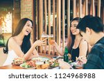 teeneger asian friends clinking ... | Shutterstock . vector #1124968988