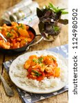 chicken in sweet and sour sauce ... | Shutterstock . vector #1124980502