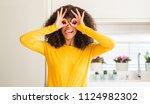 african american woman wearing... | Shutterstock . vector #1124982302