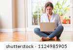 middle aged woman using laptop... | Shutterstock . vector #1124985905