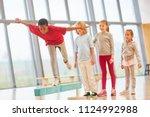 children do school sports and... | Shutterstock . vector #1124992988