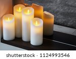 led electric candles stand in... | Shutterstock . vector #1124993546