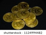 gold bitcoin pile on dark... | Shutterstock . vector #1124994482