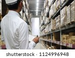 interior of warehouse. rows of... | Shutterstock . vector #1124996948