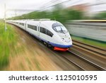 high speed train rides at high... | Shutterstock . vector #1125010595