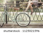 young hipster girl sitting on...   Shutterstock . vector #1125021596