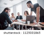 colleagues communicate with... | Shutterstock . vector #1125031865
