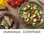 a delicious salad with sardines ... | Shutterstock . vector #1125070265