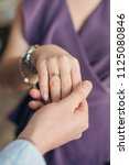 Small photo of marriage proposal, wedding ring
