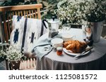 breakfast with croissants and... | Shutterstock . vector #1125081572