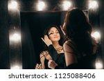 beautiful elegant brunette in a ... | Shutterstock . vector #1125088406