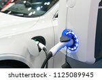 charging modern electric car on ... | Shutterstock . vector #1125089945