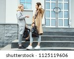 two teen girls in a street.... | Shutterstock . vector #1125119606