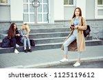 school girl with smartphone and ... | Shutterstock . vector #1125119612